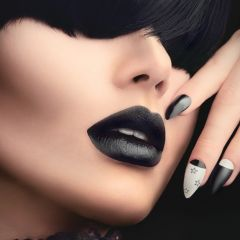 Gothic Housewives model girl with black gothic hairstyle, makeup, manicure and accessories